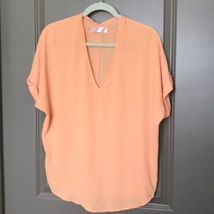 Sheer orange tunic